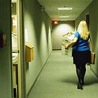 101714_Steve_Cole-Getty_WomanLeavingOffice.large.jpg